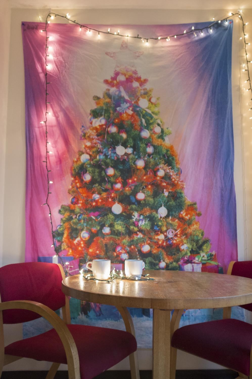 festive tapestries are one way to decorate your dorm to celebrate christmas - Christmas Dorm Decorations